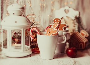 Cup of hot cocoa drink with cookie and candy. Christmas dessert